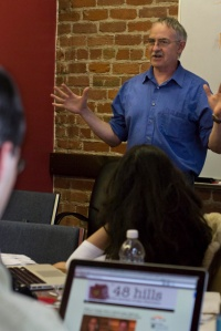 Investigative reporter and freelance journalist Tim Redmond addresses the Bay News Rising team at Pacific Media Workers Guild on June 10, 2014. (Photo by Sara Bloomberg)