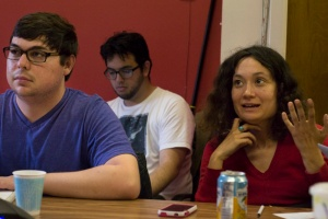 Bay News Rising member Chloe Johnson (right) speaks while Kevin Skahan (left) and Joe Fitzgerald-Rodriguez (center) listen during class at Pacific Media Workers Guild on June 10, 2014. (Photo by Sara Bloomberg)