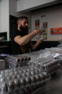 General manager Chase Chambers takes inventory of several concentrated hash varieties at The Apothecarium dispensory in San Francisco / Photo by Frank Ladra