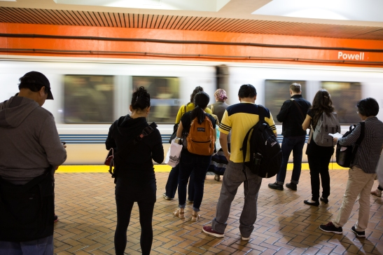 Waiting for the train at the Powell St. BART station in downtown, San Francisco. (Photo by Khaled Sayed/Bay News Rising)