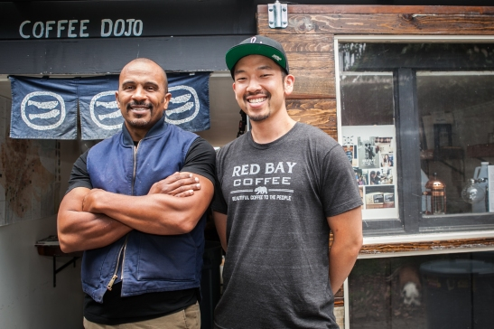 (L-R) Founder and chief executive officer of Red Bay Coffee company Keba Konte, 48 and chief operations officer Kori Chen, 31, stand in front of Garden Coffee Dojo, the company's roasting lab and production space in Oakland. (Photo by Ekevara Kitpowsong/ Bay News Rising)