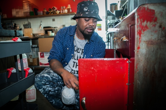 Milan Hawthorne, 35, works part time as a barista at the Chasing Lions Cafe located near City College of San Francisco Ocean Campus on Wednesday, July 22, 2015. (Photo by Ekevara Kitpowsong/Bay News Rising)