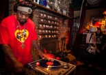 """(L-R) D.J. Milan Hawthorne """"BeatsMe"""" spins a mix of music while guests Gabby Petrocelli and Taylor Deluca enjoy the night at The Riptide bar in Sunset District, San Francisco on Thursday, July 23, 2015. (Photo by Ekevara Kitpowsong/Bay News Rising)"""