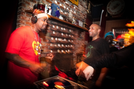 "(L-R) D.J. ""BeatsMe"" Milan Hawthorne, spins his mix beats while D.J. Shawn Castello enjoys the music next to him at The Riptide bar in Sunset District, San Francisco on Thursday, July 23, 2015. (Photo by Ekevara Kitpowsong/Bay News Rising)"