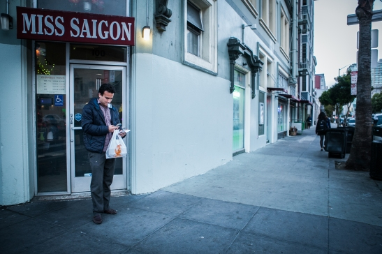 A part time postmates courier Homero Hidalgo, 35, left Miss Saigon Vietnamese Cuisine after picking up food for the customer who requested delivery through the Postmates app on Friday, July 17, 2015. (Photo by Ekevara Kitpowsong/Bay News Rising)