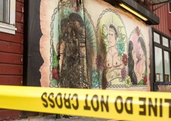 Yellow police tape surrounding the recently burnt LGBT mural Por Vida by Manuel Paul on Bryant St (Photo by Khaled Sayed/Bay News Rising)
