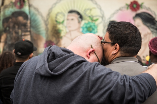A couple mourns the damage to a vandalize LGBT-themed mural (Photo by Khaled Sayed/Bay News Rising)