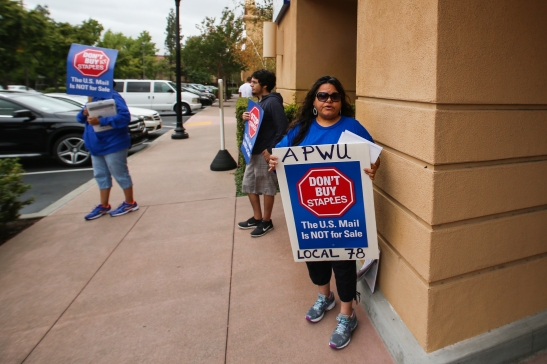Silvia Montes, union postal worker since 1989, pickets outside a Staples store in Pleasant Hill on Thursday, July 9. (Emilia Rosales/Bay News Rising)
