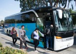 Employees board a shuttle bus headed to Genentech offices. Genentech drivers, along with others from companies like Zynga and Apple, work for Compass Transportation. Drivers are seeking union representation through the Teamsters for contracts with better wages and benefits. (Photo by Erasmo Martinez/Bay News Rising)