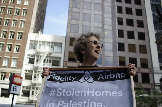 Karen Platt, a member of Jewish Voice for Peace, shouts a chant urging Fidelity to stop investing in Airbnb at their building in downtown San Francisco on Friday, June 3, 2016. (Photo by Grady Penna / Bay News Rising)
