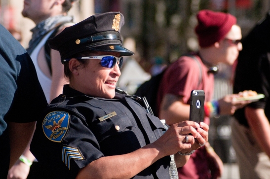 SFPD Officer Chacon taking photos of Pride attendees