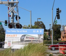 Signs advertising SMART are positioned along train tacks in Petaluma. (Photo by Mariana Raschke/Bay News Rising)