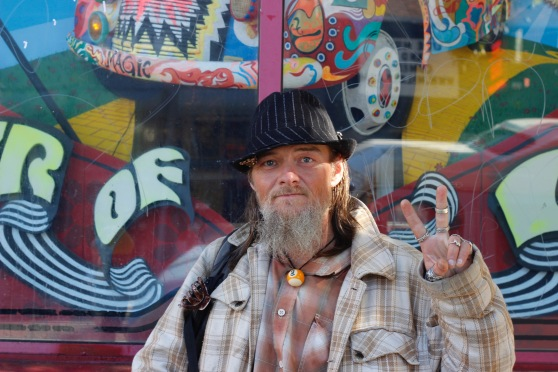 Patrick Bral, a homeless man who frequents the Upper Haight, poses for a photo in front of Amoeba Music on Haight Street on Saturday, June 25, 2016. (Photo by Grady Penna / Bay News Rising)