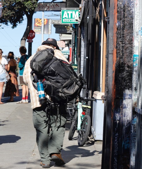 Patrick Bral continues his walk down Haight Street with most of his belongings strapped to his back on Saturday, June 25, 2016.
