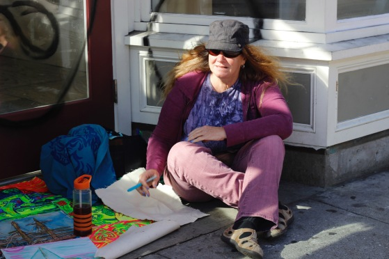 Local painter Cynthia Jones lays out her artwork on the sidewalk to sell to passers-by on Haight Street on Saturday, June 25, 2016. (Photo by Grady Penna / Bay News Rising)